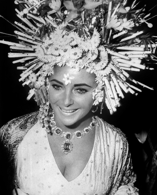 Elizabeth Taylor wears Bulgari jewellery at the masked ball, Hotel Ca'Rezzonico, Venice
