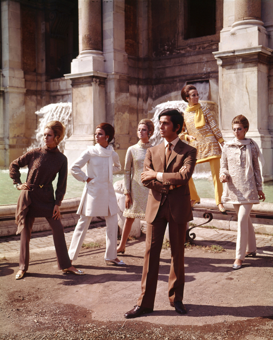 Valentino posing with models nearby Trevi Fountain, Rome